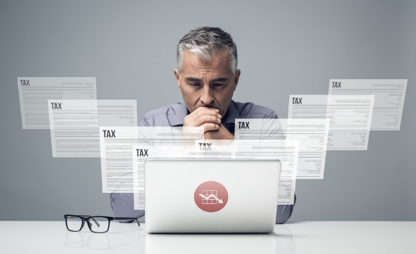 Man Viewing Tax Forms on Computer